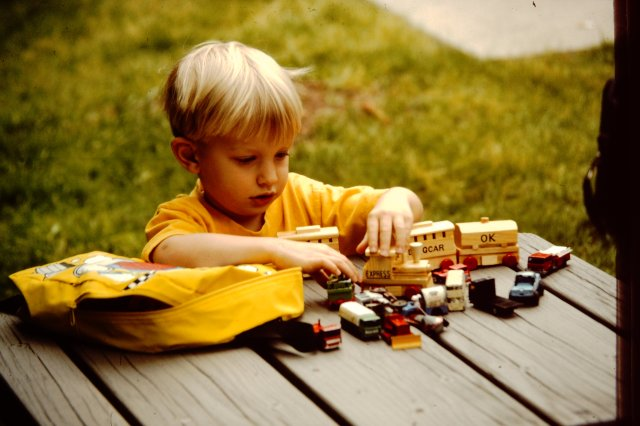 Phillip with his cars and trains