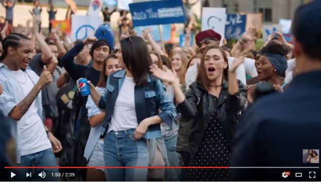 white model accepted by ultra cool black male dance through pepsi into leadership